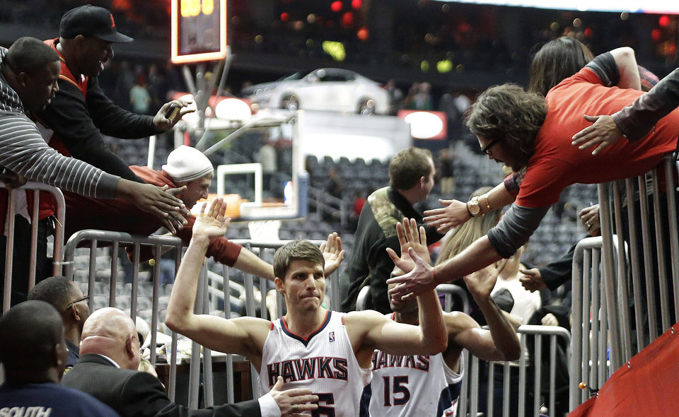 Photo - Atlanta Hawks  guard Kyle Korver greets fans as he leaves the court after an NBA basketball game against the Boston Celtics on Friday, Jan. 25, 2013, in Atlanta. Korver scored 27 points to help Atlanta win 123-111 in double-overtime. (AP Photo/John Bazemore)