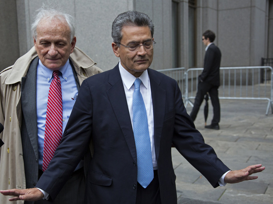 Photo -   Rajat Gupta, right, declines to answer questions as he leaves federal court in New York, Wednesday, Oct. 24, 2012 after the former Goldman Sachs and Procter & Gamble Co. board member was sentenced Wednesday to 2 years in prison for feeding inside information about board dealings with a billionaire hedge fund owner who was his friend. Left is Gupta's attorney Gary Naftalis. (AP Photo/Craig Ruttle)