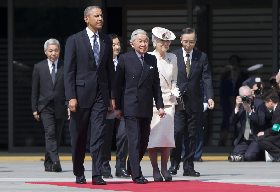Photo - President Barack Obama, front left, walks with Japanese Emperor Akihito, second left in front, and his wife Empress Michiko as he arrives for a welcome ceremony at the Imperial Palace in Tokyo, Thursday, April 24, 2014. Facing fresh questions about his commitment to Asia, Obama will seek to convince Japan's leaders Thursday that he can deliver on his security and economic pledges, even as the crisis in Ukraine demands U.S. attention and resources elsewhere. (AP Photo/Carolyn Kaster)