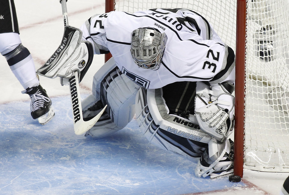 Photo - Los Angeles Kings goalie Jonathan Quick (32) blocks a goal attempt against San Jose Sharks during the third period in Game 3 of their second-round NHL hockey Stanley Cup playoff series, Saturday, May 18, 2013, in San Jose, Calif. (AP Photo/Tony Avelar)
