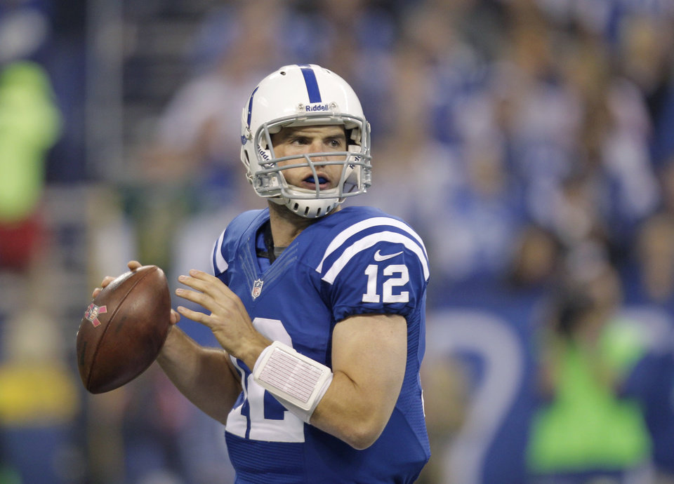 Photo -   Indianapolis Colts quarterback Andrew Luck passes during the first half of an NFL football game against the Green Bay Packers in Indianapolis, Sunday, Oct. 7, 2012. (AP Photo/Michael Conroy)