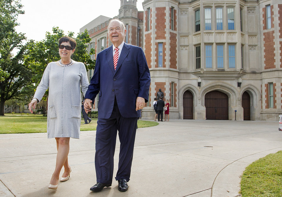 Photo - University of Oklahoma president David Boren walks hand in hand with wife Molly Shi as they leave the press conference where to announce his retirement in Norman, Okla. on Wednesday, Sept. 20, 2017.  Photo by Chris Landsberger, The Oklahoman