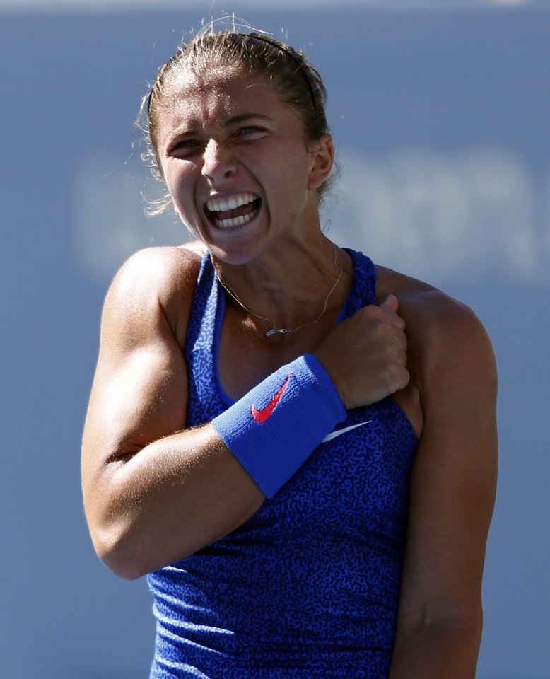 Photo - Sara Errani, of Italy, reacts after defeating Venus Williams, of the United States, during the third round of the 2014 U.S. Open tennis tournament, Friday, Aug. 29, 2014, in New York. (AP Photo/Matt Rourke)