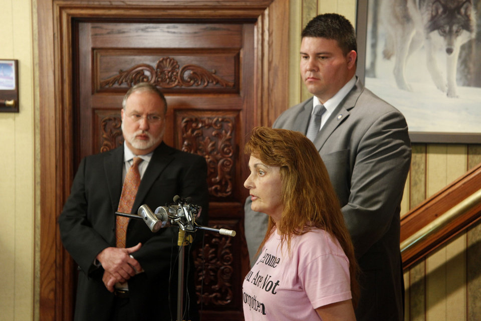 A former pharmacist's supporter, Karen Monahan, talks to reporters Wednesday while his new attorney Doug Friesen, left, and state Sen. Ralph Shortey listen. <strong>DOUG HOKE - THE OKLAHOMAN</strong>