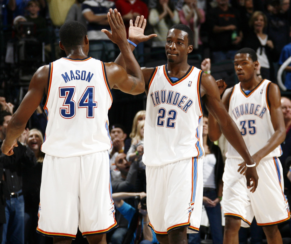 Photo - Oklahoma City's Desmond Mason (34), Jeff Green (22) and Kevin Durant (35) celebrate late in the fourth quarter of the NBA basketball game between the Toronto Raptors and the Oklahoma City Thunder at the Ford Center in Oklahoma City, Friday, Dec. 19, 2008. The Thunder won, 91-83. BY NATE BILLINGS, THE OKLAHOMAN