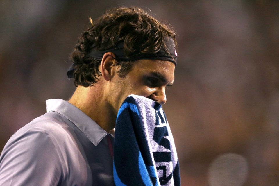 Photo - Switzerland's Roger Federer reacts during his semifinal loss to Britain's Andy Murray at the Australian Open tennis championship in Melbourne, Australia, Friday, Jan. 25, 2013. (AP Photo/Mark Kolbe,Pool)