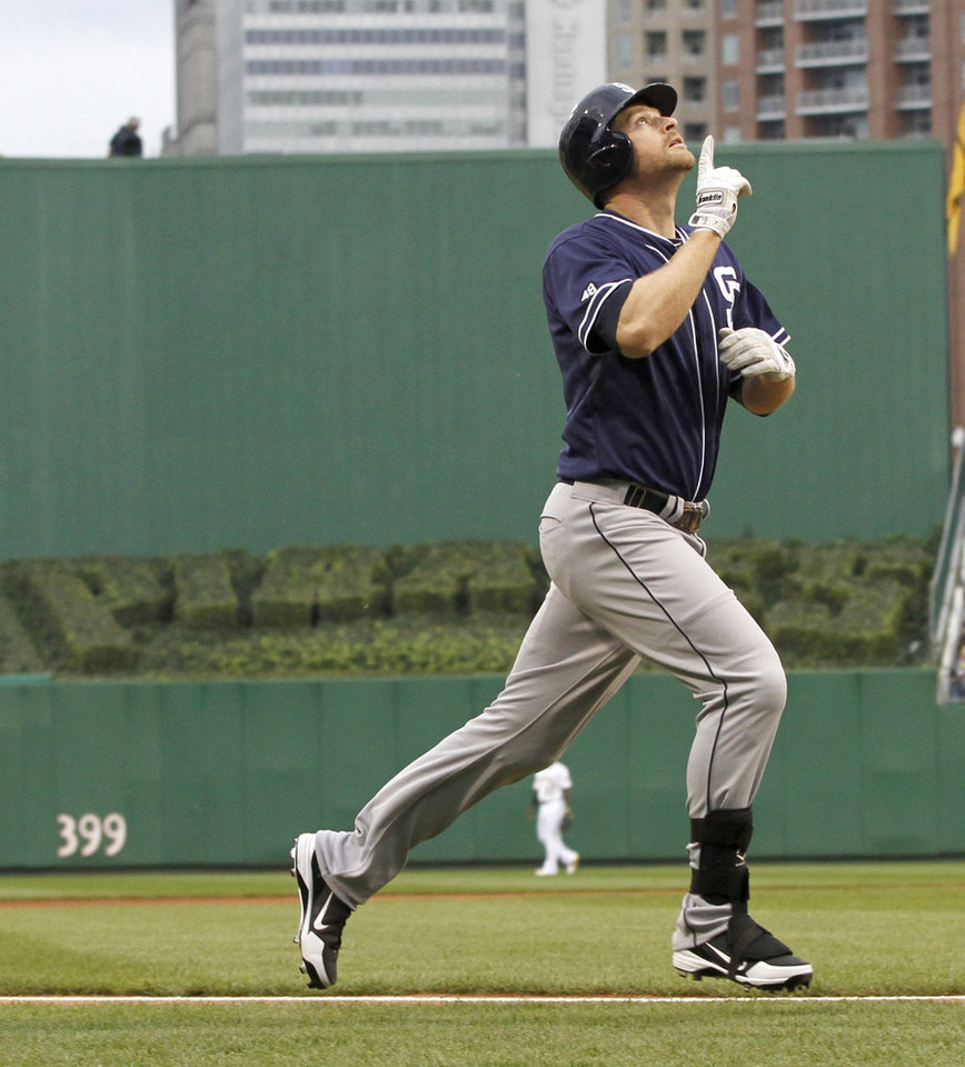 Photo -   San Diego Padres' Chase Headley points skyward as he heads home after hitting a home run against the Pittsburgh Pirates in the first inning of the baseball game on Saturday, Aug. 11, 2012, in Pittsburgh. (AP Photo/Keith Srakocic)