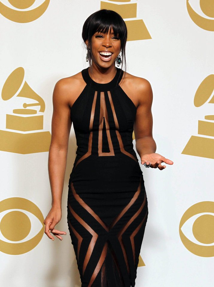 Photo - Kelly Rowland poses backstage at the 55th annual Grammy Awards on Sunday, Feb. 10, 2013, in Los Angeles. (Photo by Matt Sayles/Invision/AP)