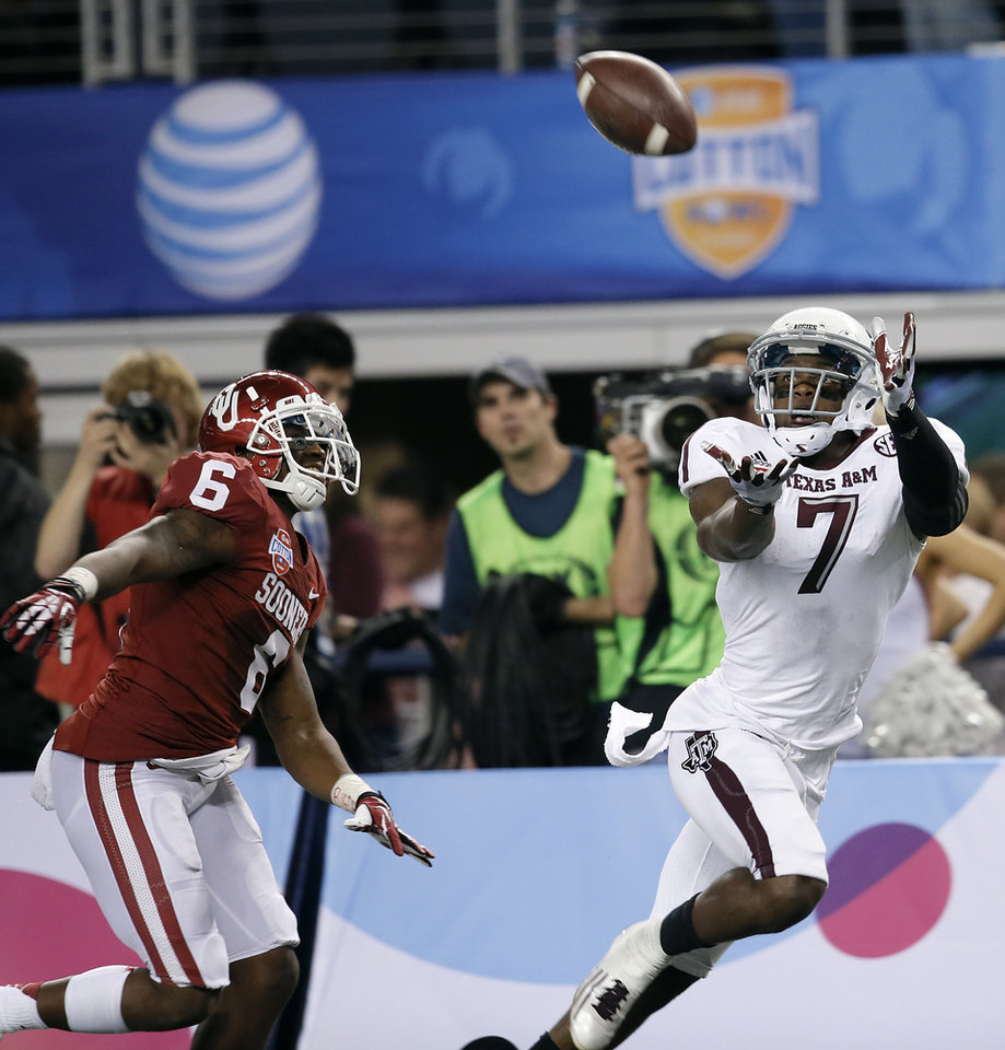 Texas A&M's Uzoma Nwachukwu (7) makes a touchdown catch in front of Oklahoma's Demontre Hurst (6) during the college football Cotton Bowl game between the University of Oklahoma Sooners (OU) and Texas A&M University Aggies (TXAM) at Cowboy's Stadium on Friday Jan. 4, 2013, in Arlington, Tx. Photo by Chris Landsberger, The Oklahoman
