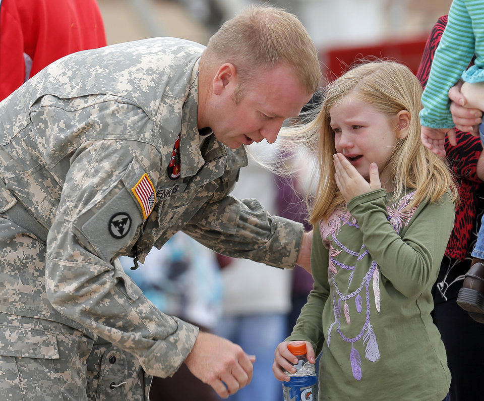Sierria, 6, cries as she says goodbye to her dad Warrant Officer John Jenkins following an Oklahoma Aviation Command mobilization ceremony  for Detachment 1, Company C, 2-149th General Support Aviation Battalion at the Army Aviation Support Facility in Lexington, Okla., Sunday, Sept. 16, 2012. The soldiers will receive additional training at Fort Hood before being deployed to Afghanistan. Photo by Sarah Phipps, The Oklahoman