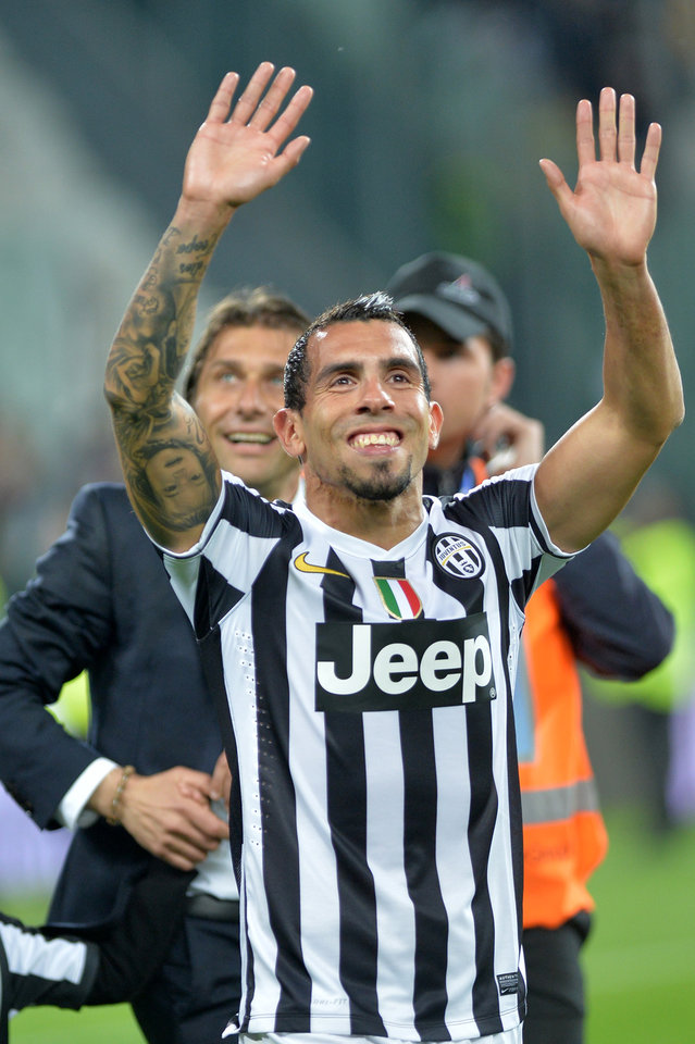 Photo - Juventus' Carlos Tevez celebrates at the end of a Serie A soccer match againsts Atalanta, at the Juventus stadium, in Turin, Italy, Monday, May 6, 2014. Juventus clinched its third straight and 30th overall Serie A title. (AP Photo/Massimo Pinca)