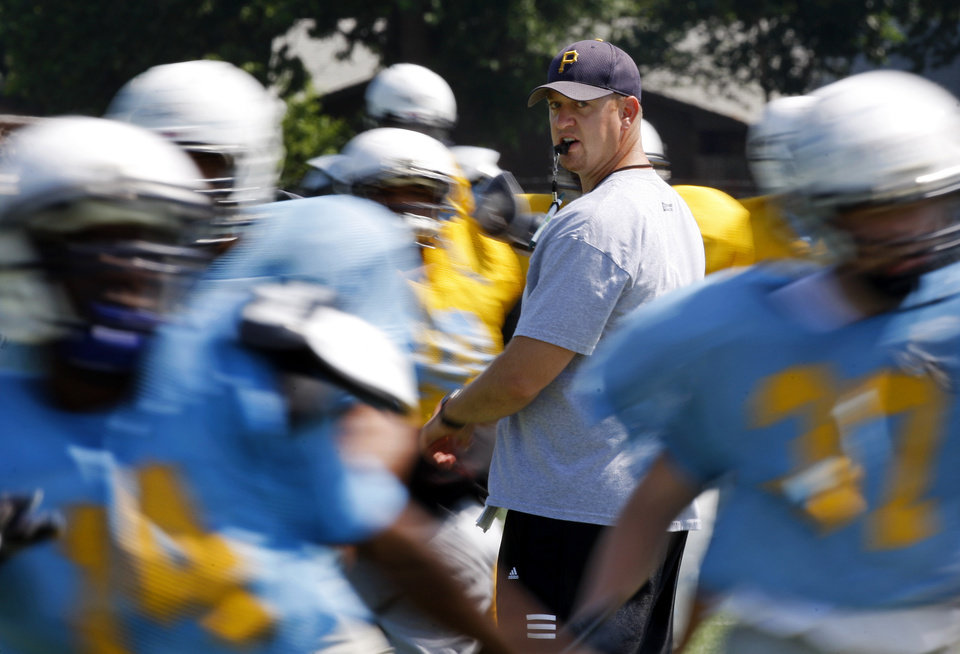 Photo - New Putnam CIty West coach Rocky Martin works with his players during spring practice on May 18. Photo by Bryan Terry, The Oklahoman