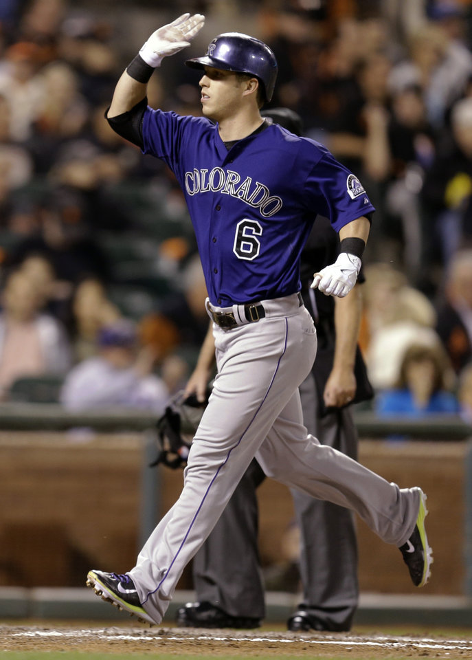 Photo - Colorado Rockies' Corey Dickerson celebrates after hitting a home run off San Francisco Giants' Tim Hudson in the fifth inning of a baseball game Wednesday, Aug. 27, 2014, in San Francisco. (AP Photo/Ben Margot)