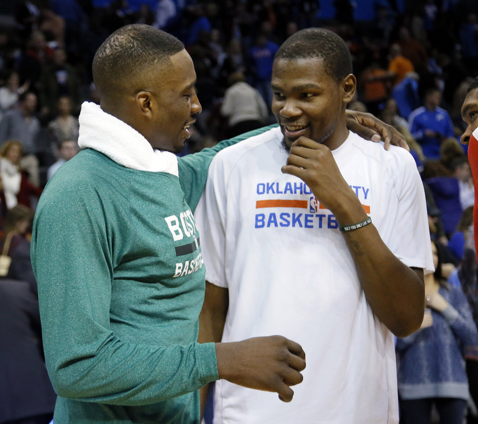 Photo - Oklahoma City's Kevin Durant (35) talks with Boston's Jeff Green (8) following the NBA game between the Oklahoma City Thunder and the Boston Celtics at the Chesapeake Energy Arena., Sunday, Jan. 5, 2014. Photo by Sarah Phipps, The Oklahoman
