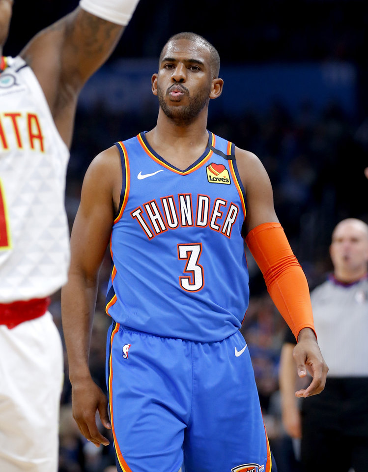 Photo - Oklahoma City's Chris Paul (3) reacts after a 3-point basket to end the first quarter during the NBA basketball game between the Oklahoma City Thunder and the Atlanta Hawks at the Chesapeake Energy Arena in Oklahoma City,Friday, Jan. 24, 2020.  [Sarah Phipps/The Oklahoman]