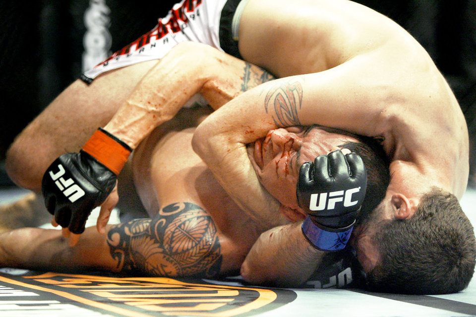 Photo - Nate Quarry, left, fights Tim Credeur during the UFC Fight Night at the Cox Convention Center. Photo by Bryan Terry, The Oklahoman