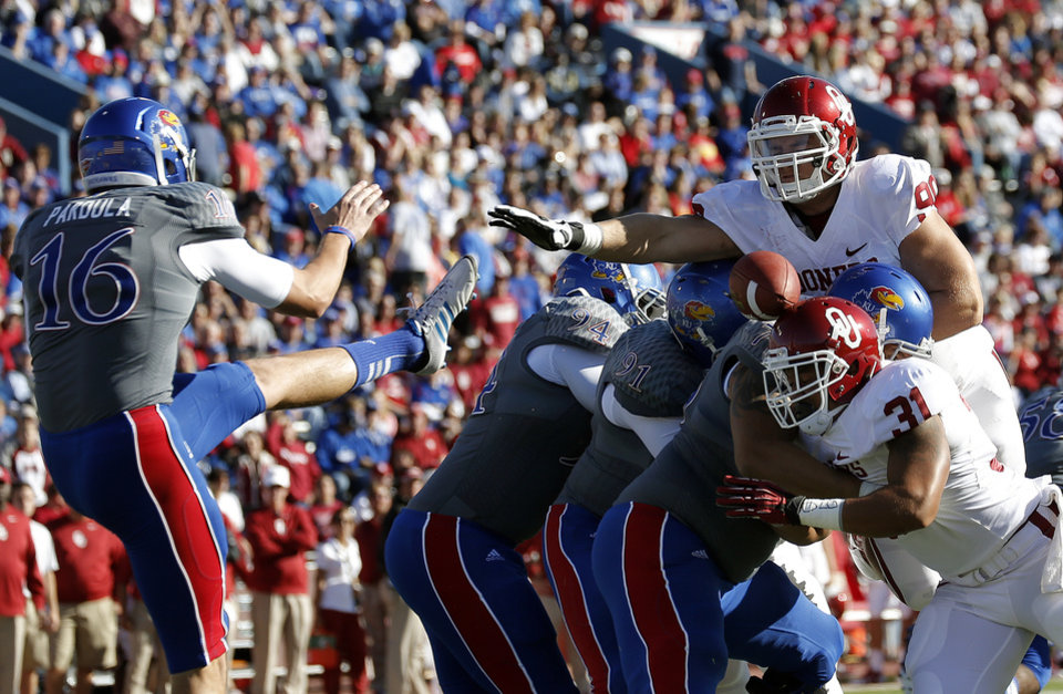Oklahoma blocks a Kansas punt for a safety during the college football game between the University of Oklahoma Sooners (OU) and the University of Kansas Jayhawks (KU) at Memorial Stadium in Lawrence, Kan., Saturday, Oct. 19, 2013. Photo by Sarah Phipps, The Oklahoman