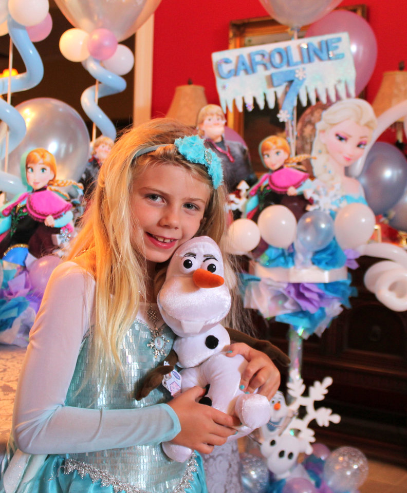 Photo - In this May 31, 2014 photo made available by Kristin Calder, shows her daughter Caroline Calder at her seventh birthday party themed after the Disney movie
