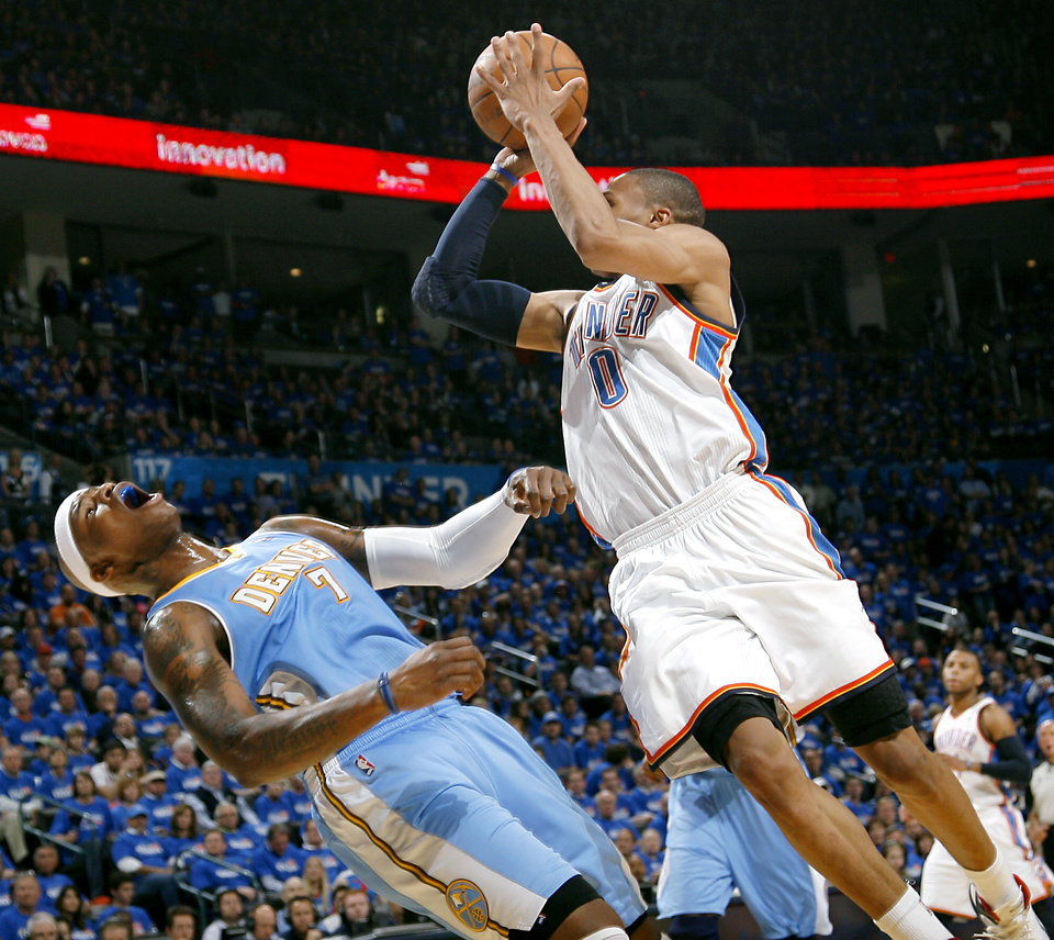 Oklahoma City\'s Russell Westbrook is fouled by Denver\'s Al Harrington during the first round NBA Playoff basketball game between the Thunder and the Nuggets at OKC Arena in downtown Oklahoma City on Wednesday, April 20, 2011. The Thunder beat the Nuggets 106-89 and lead the series 2-0. Photo by John Clanton, The Oklahoman