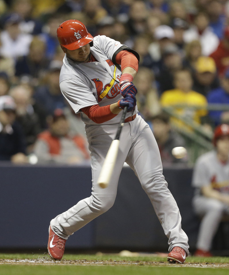 Photo - St. Louis Cardinals' Jhonny Peralta hits a home run against Milwaukee Brewers starting pitcher Matt Garza during the second inning of a baseball game Monday, April 14, 2014, in Milwaukee. (AP Photo/Jeffrey Phelps)