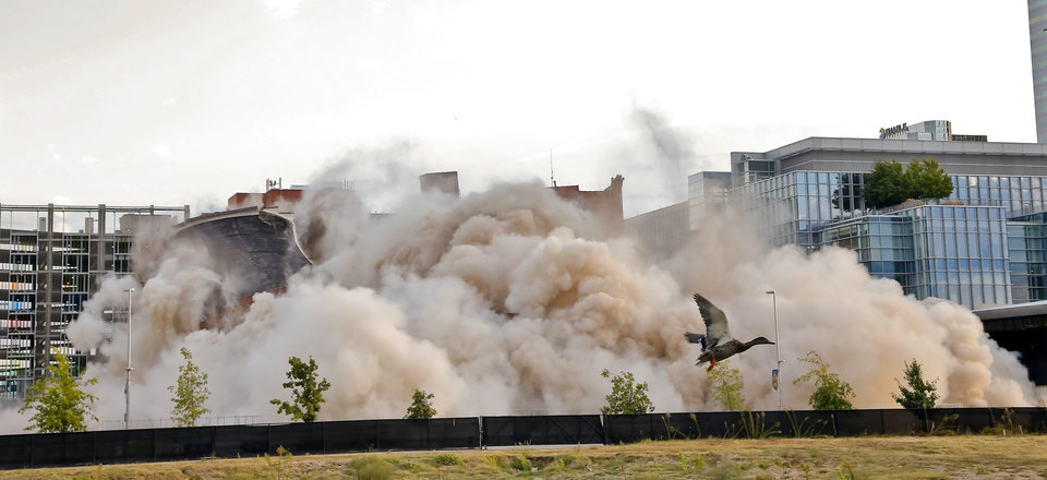 Photo - Hotel Black and the adjoining parking garage in downtown Oklahoma City are taken down during an implosion by Midwest Wrecking Company on Sunday, Sept. 13, 2015, in Oklahoma City, Okla.  Photo by Chris Landsberger, The Oklahoman