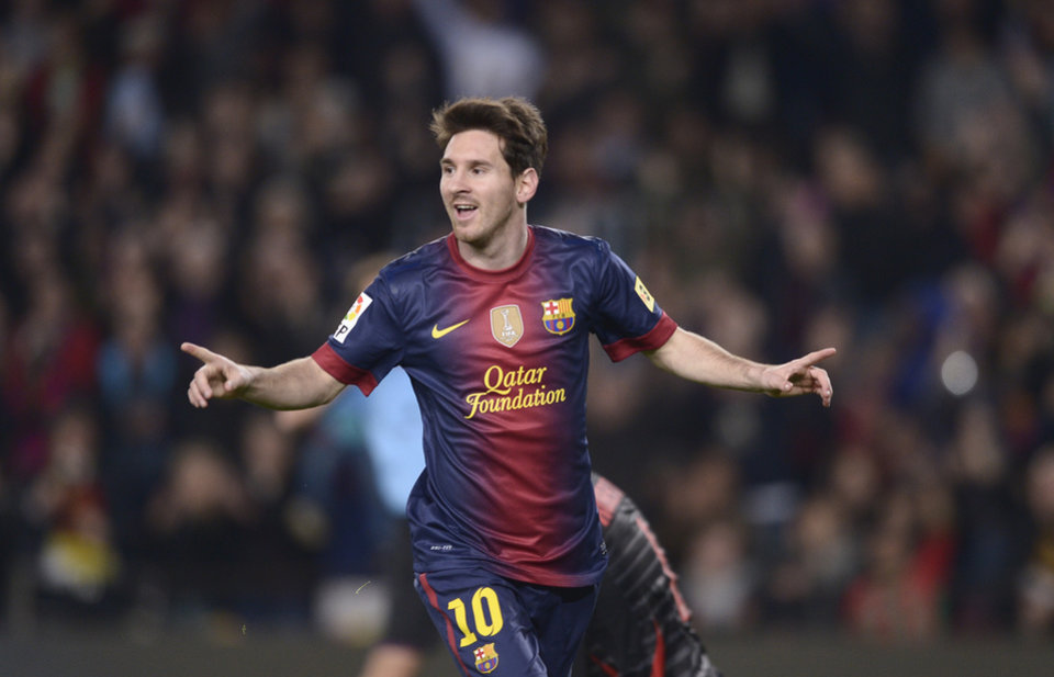 FC Barcelona's Lionel Messi, from Argentina reacts after scoring against Zaragoza during a Spanish La Liga soccer match a at the Camp Nou stadium in Barcelona, Spain, Saturday, Nov. 17, 2012. (AP Photo/Manu Fernandez)