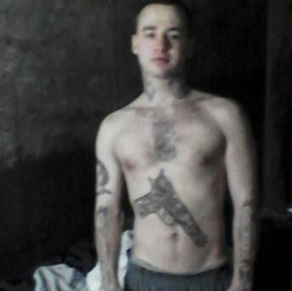 Convicted murderer Cliffton Putman, 24, posted this photo to his Facebook page Aug. 7. The tattoo on his stomach is a handgun. <strong>Facebook - Facebook</strong>
