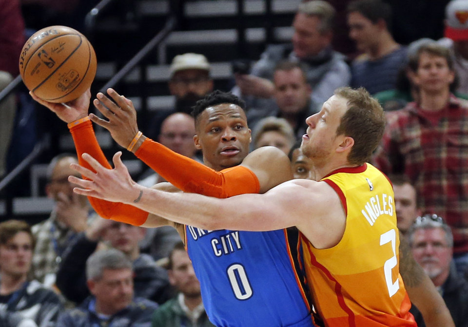 Photo - Utah Jazz forward Joe Ingles (2) guards Oklahoma City Thunder guard Russell Westbrook (0) in the second half during an NBA basketball game, Monday, March 11, 2019, in Salt Lake City. (AP Photo/Rick Bowmer)