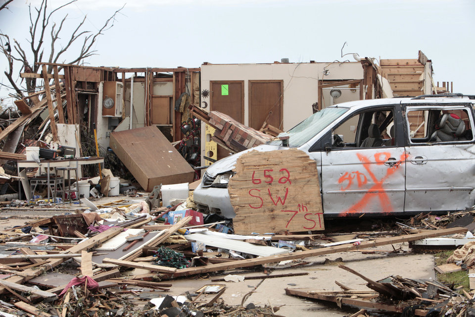 Photo - Homes destroyed in the tornados with big address markers so insurance companies can find them in the neighborhood behind the Warren Theater, Thursday, May 23, 2013.  Photo by David McDaniel, The Oklahoman