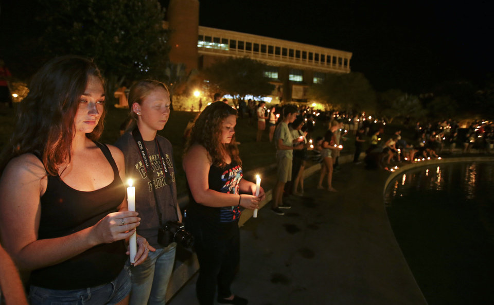 Photo - Students and supporters take part in a candle light vigil at the University of Central Florida, Wednesday, Sept. 3, 2014, in Orlando, Fla., to honor Steven Sotloff, the second American journalist to be beheaded by the Islamic State group in two weeks. Sotloff attended University of Central Florida between 2002 and 2004. (AP Photo/John Raoux)