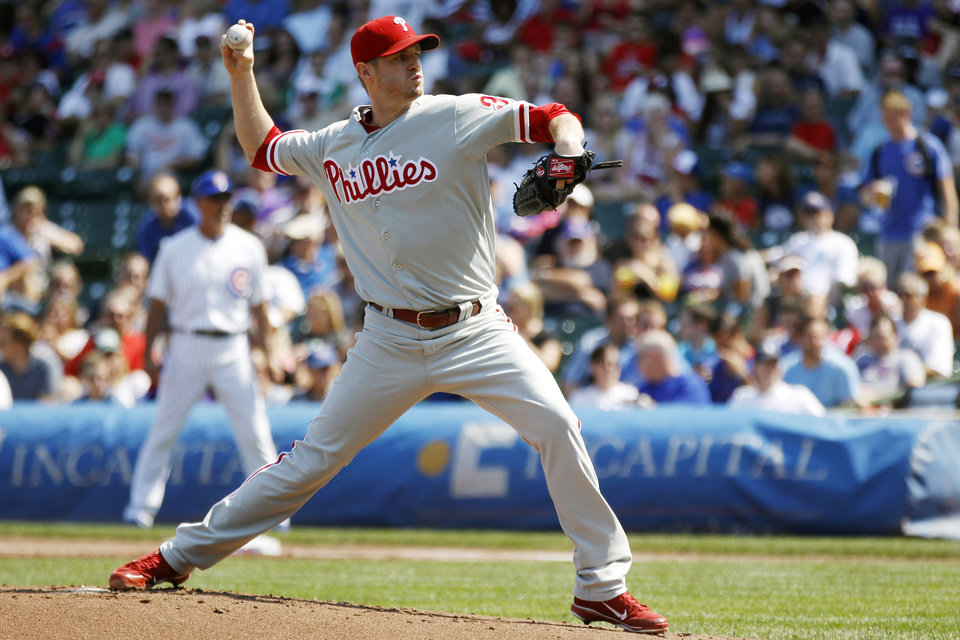 Photo - Philadelphia Phillies starting pitcher Kyle Kendrick pitches against the Chicago Cubs during the first inning of a baseball game on Sunday, Sept. 1, 2013, in Chicago. (AP Photo/Andrew A. Nelles)