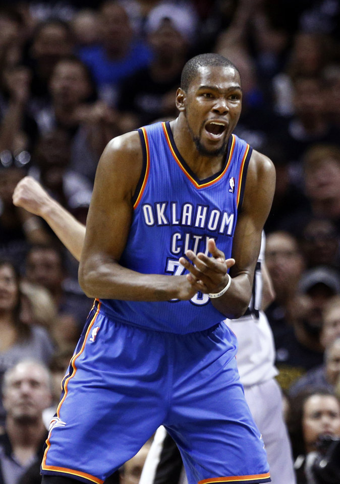Photo - Oklahoma City's Kevin Durant (35) reacts to a charge call during Game 1 of the Western Conference Finals in the NBA playoffs between the Oklahoma City Thunder and the San Antonio Spurs at the AT&T Center in San Antonio, Monday, May 19, 2014. Photo by Sarah Phipps, The Oklahoman