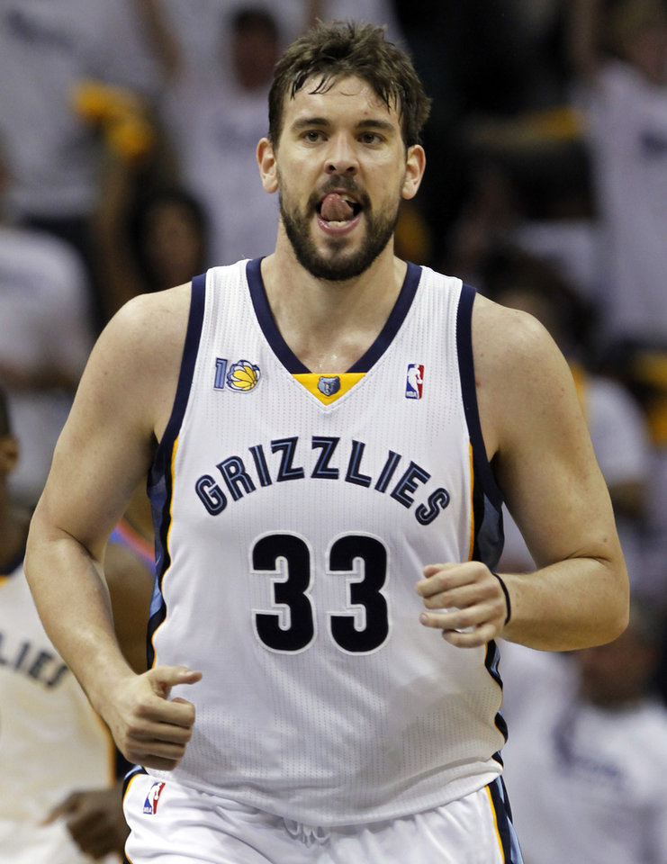 Photo - Memphis Grizzlies center Marc Gasol, of Spain, heads back up the court after the Grizzlies scored against the Oklahoma City Thunder during the first half of Game 4 of a second-round NBA basketball playoff series on Monday, May 9, 2011, in Memphis, Tenn. (AP Photo/Lance Murphey)