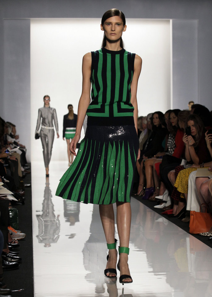 Photo -   The Michael Kors Spring 2013 collection is modeled during Fashion Week in New York, Wednesday, Sept. 12, 2012. (AP Photo/Richard Drew)
