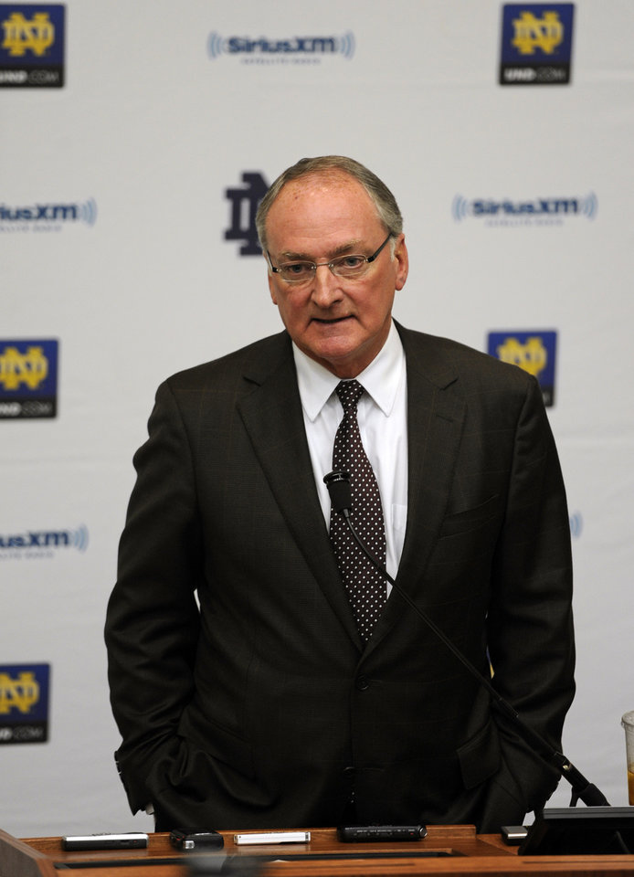 Photo - Notre Dame Athletic Director Jack Swarbrick speaks to reporters during an NCAA college football news conference regarding a hoax involving linebacker Manti Te'o on Wednesday, Jan. 16, 2013, in South Bend, Ind. Notre Dame issued a release Wednesday saying a story about Te'o's girlfriend dying, which he said inspired him to play better as he helped the Fighting Irish get to the BCS title game, turned out to be a hoax apparently perpetrated against the linebacker. (AP Photo/Joe Raymond)