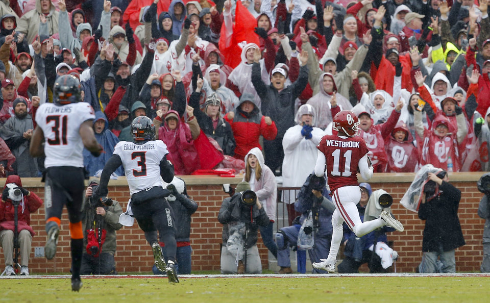 Photo - Oklahoma's Dede Westbrook (11) scores a touchdown during the Bedlam college football game between the Oklahoma Sooners (OU) and the Oklahoma State Cowboys (OSU) at Gaylord Family - Oklahoma Memorial Stadium in Norman, Okla., Saturday, Dec. 3, 2016. Oklahoma won 38-20. Photo by Bryan Terry, The Oklahoman
