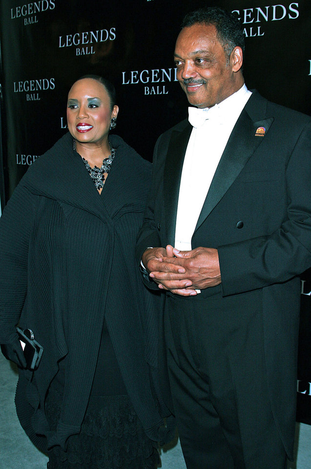 Photo - FILE - In this May, 14, 2005 file photo, Rev. Jesse Jackson and daughter Santita Jackson arrive at the Legends Ball, in Santa Barbara, Calif. Santita says her brother, Jesse Jackson, Jr., was better suited to the life he knew in his 20s pursuing a divinity degree at a Chicago seminary, which allowed him to take frequent breaks to think and