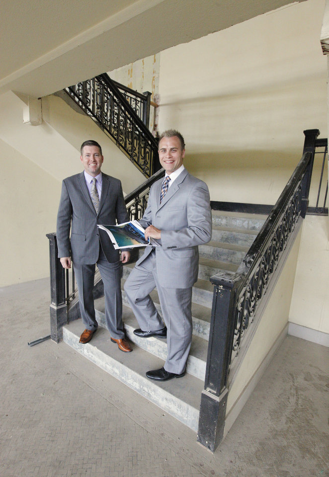Photo -  Aaron Soward and Jeff Dixon, partners in Provision Concepts, stand on the stairway to the mezzanine inside the Buick Building, which will soon be home to Broadway 10 Chophouse. Photo by Paul B. Southerland     PAUL B. SOUTHERLAND -  PAUL B. SOUTHERLAND