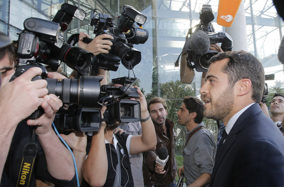Photo -   Aurelien Hamelle, French lawyer for the British royal couple, arrives in court in Nanterre, on the outskirts of Paris, Monday, Sept, 17, 2012 to seek an injunction against the Mondadori publishing house, owned by former Premier Silvio Berlusconi, which published a 26-page spread of topless photos of Prince William's wife Kate on Monday, to prevent further dissemination of the images. St. James's Palace said Sunday that family lawyers would file a criminal complaint against the unidentified photographer or photographers involved. The palace said it would be up to French prosecutors to decide whether to investigate and pursue a criminal case for breach of privacy or trespassing. (AP Photo/Francois Mori)