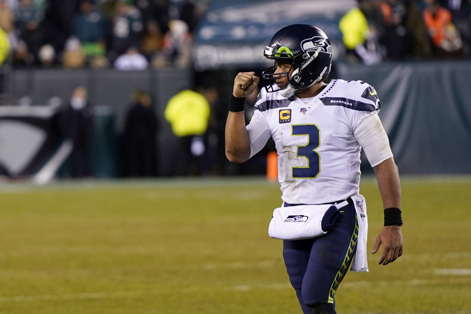 Photo - Seattle Seahawks' Russell Wilson reacts during the second half of an NFL wild-card playoff football game against the Philadelphia Eagles, Sunday, Jan. 5, 2020, in Philadelphia. (AP Photo/Chris Szagola)