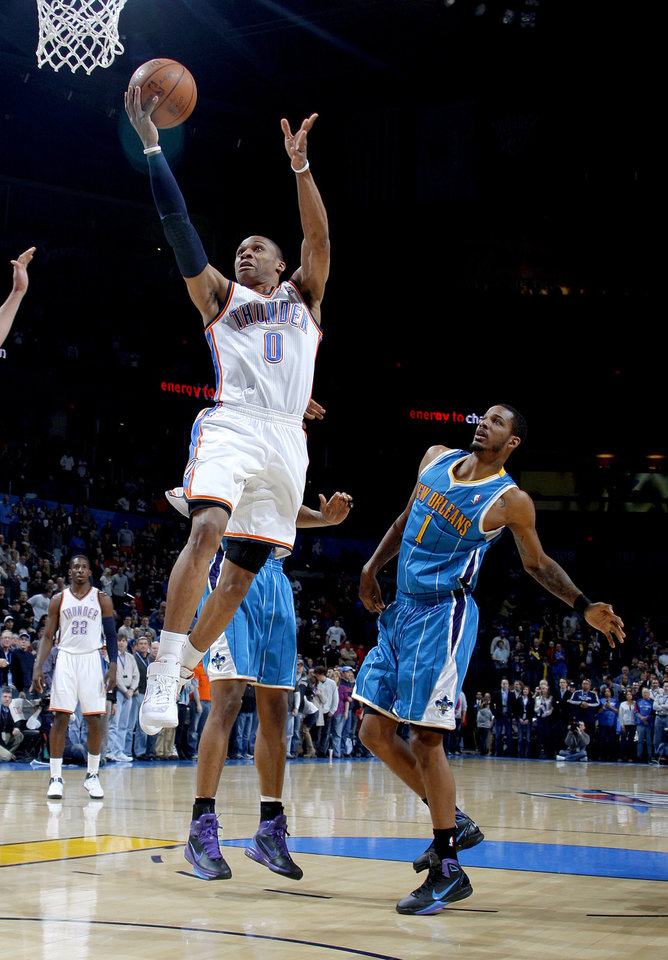 Photo - Oklahoma City's Russell Westbrook (0) goes past New Orlean during the NBA basketball game between the Oklahoma City Thunder and the New Orleans Hornets, Wednesday, Feb. 2, 2011 at the Oklahoma City Arena. Photo by Sarah Phipps, The Oklahoman
