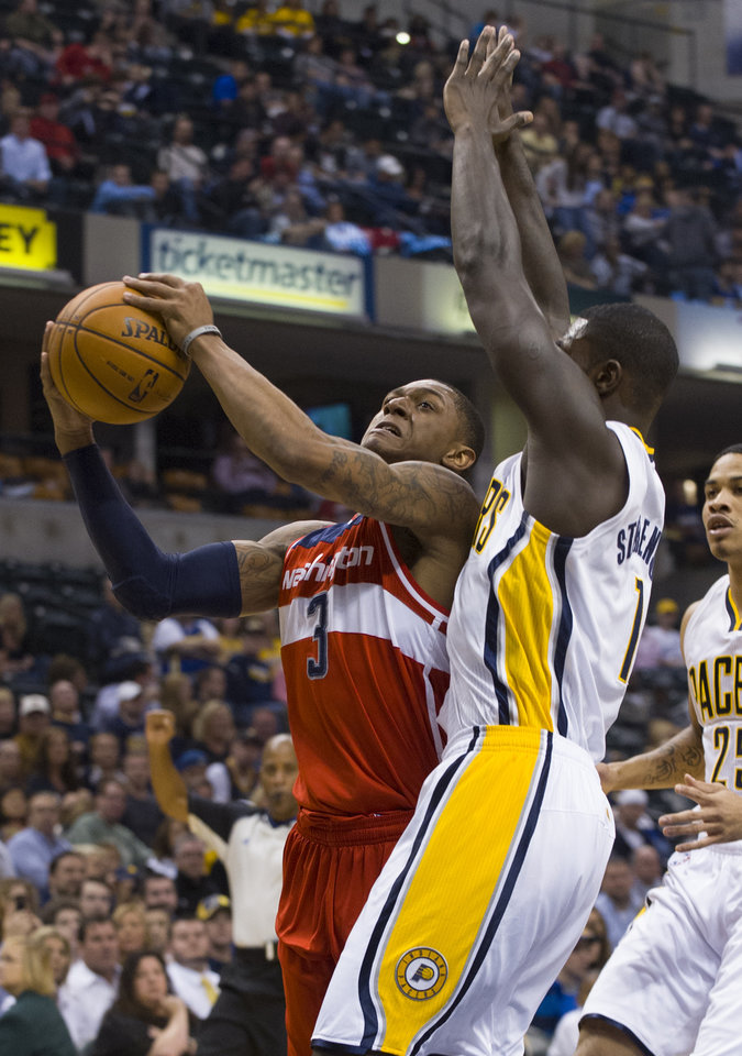 Washington Wizards shooting guard Bradley Beal (3) takes the ball around Indiana Pacers shooting guard Lance Stephenson (1) during first-half action in an NBA basketball game in Indianapolis, Saturday, Nov. 10, 2012. (AP Photo/Doug McSchooler)