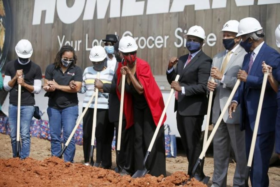 Photo -  Dignitaries gather for a photo during the groundbreaking for a new Homeland grocery store at the corner of NE 36 and Lincoln Boulevard in Oklahoma City Thursday.  [Bryan Terry/The Oklahoman]