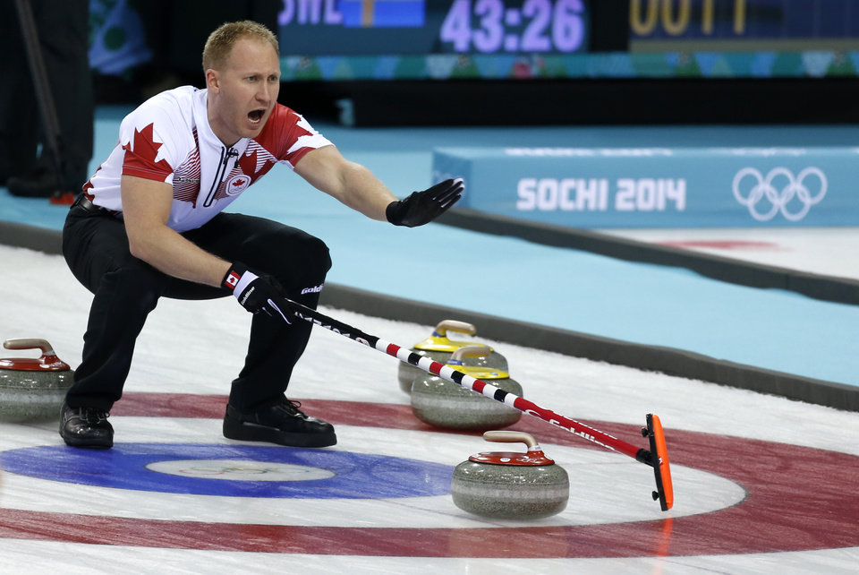 Photo - Canada's skip Brad Jacobs shouts instructions from the house during curling competition against Russia at the 2014 Winter Olympics, Wednesday, Feb. 12, 2014, in Sochi, Russia. (AP Photo/Robert F. Bukaty)