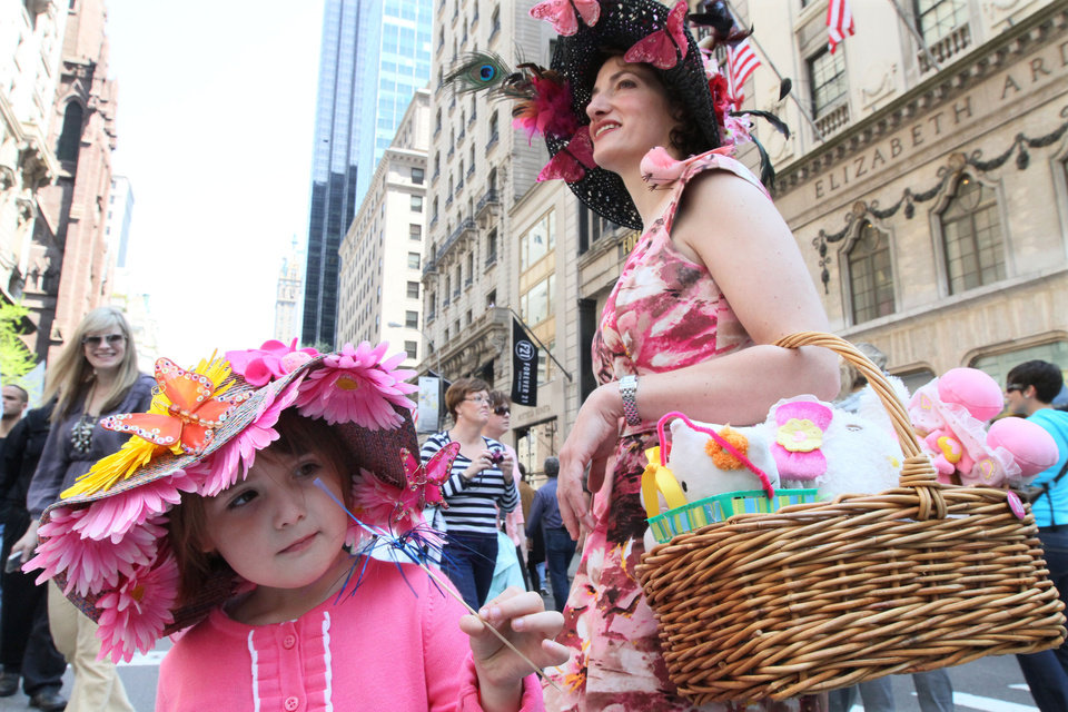 Photo -   Julia Scott, 4, of Fairlawn, N.J., left, and her mother Regina Scotti, right, take part in the Easter Parade along New York's Fifth Avenue Sunday April 24, 2011. (AP Photo/Tina Fineberg)