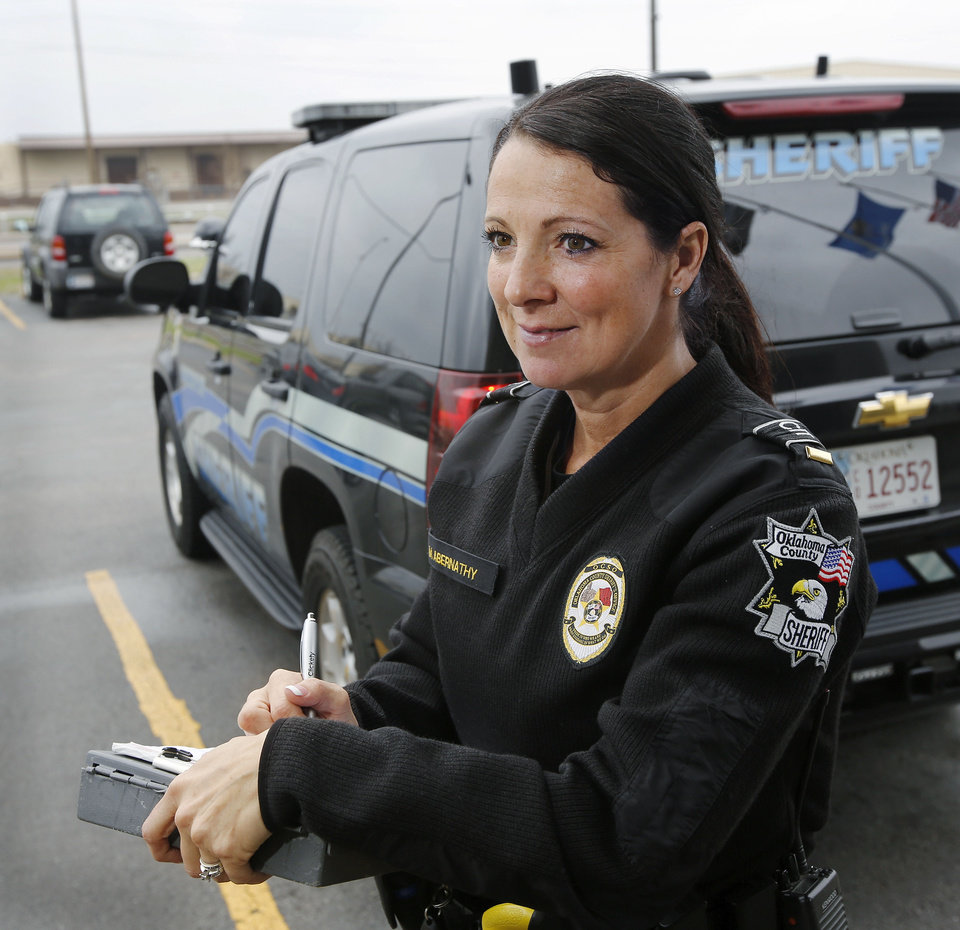 Photo - Lt. Melissa Abernathy, a patrol lieutenant in the Oklahoma County Sheriff's Department, is one of the people in charge of the OKC metro unit. The unit responds to mental health calls and is responsible for transporting patients.  Jim Beckel - THE OKLAHOMAN