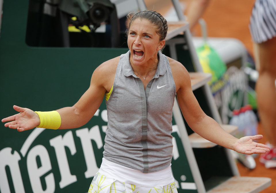 Photo - Italy's Sara Errani reacts after defeating Serbia's Jelena Jankovic during their fourth round match of  the French Open tennis tournament at the Roland Garros stadium, in Paris, France, Monday, June 2, 2014. (AP Photo/David Vincent)