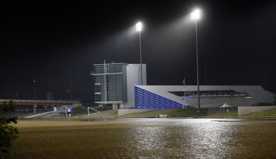 Photo - A view from the south of the Chesapeake Finish Line Tower and the Devon Boathouse with stadium lights on the Oklahoma River at the Boathouse District in Oklahoma City, Thursday, June 27, 2013. Photo by Nate Billings, The Oklahoman