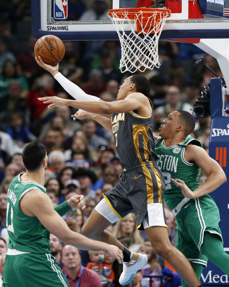 Photo - Oklahoma City's Darius Bazley (7) tries to score against Boston's Grant Williams (12), right, as Enes Kanter (11) looks on in the first quarter during an NBA basketball game between the Oklahoma City Thunder and the Boston Celtics at Chesapeake Energy Arena in Oklahoma City, Sunday, Feb. 9, 2020. [Nate Billings/The Oklahoman]