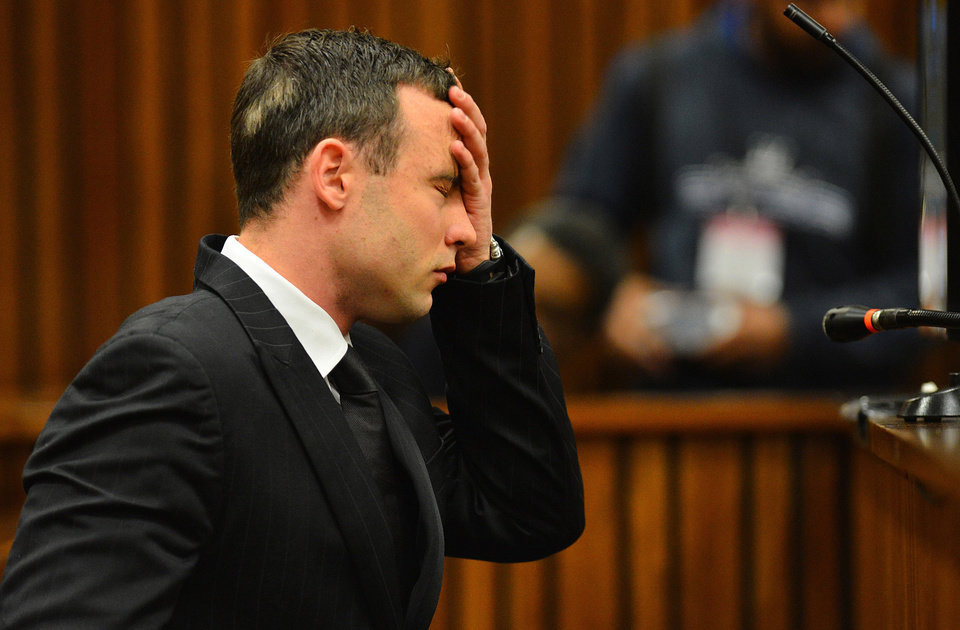 Photo - Oscar Pistorius listens to evidence in court in Pretoria, South Africa, June 30, 2014. The murder trial of Pistorius resumed Monday,after one month during which mental health experts evaluated the athlete to determine if he has an anxiety disorder that could have influenced his actions on the night he killed girlfriend Reeva Steenkamp. (AP Photo/Phill Magakoe, Pool)